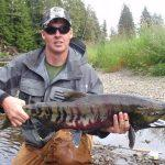 Ty Lord catches a nice Chum Salmon while fly fishing at the lodge