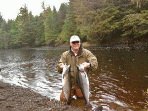 Lodge guest sporting two Silver Salmon