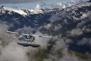Misty Fjords floatplane flightseeing among clouds