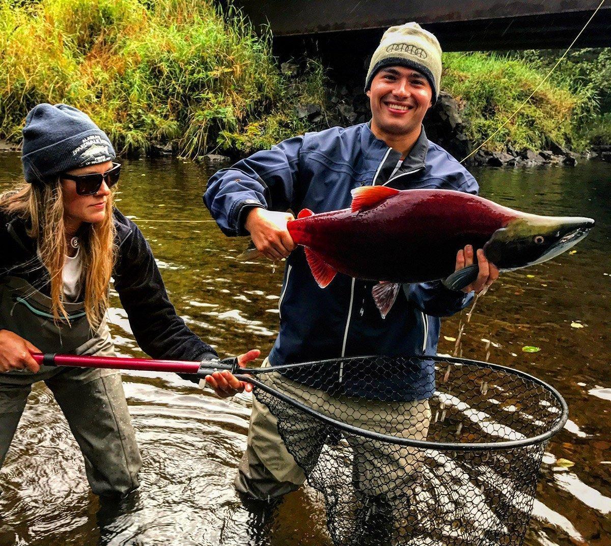 Orvis guide Kris Atkins nets sockeye salmon