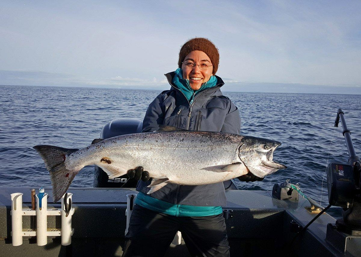 Author Chris Brewer with the Alaska king salmon she caught while trolling