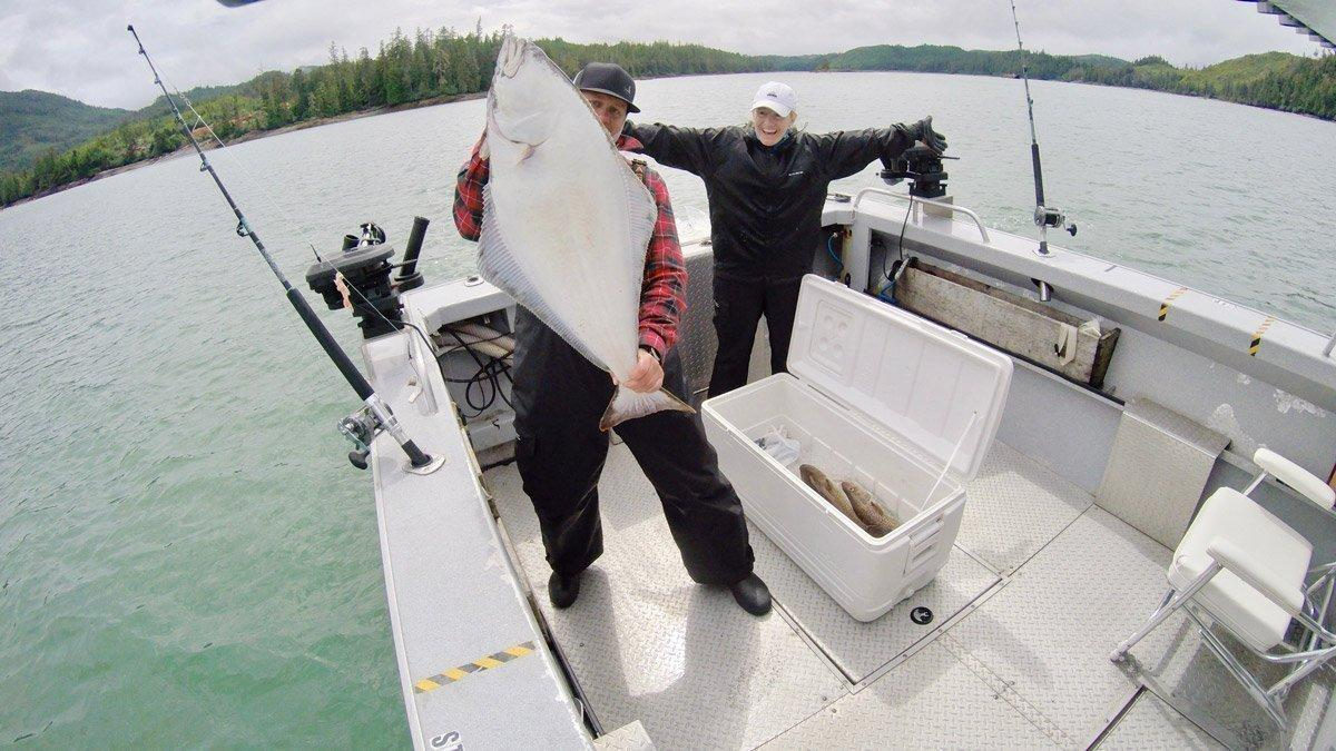 Lodge guest Russ Andrus lands this beauty while Alaska halibut fishing