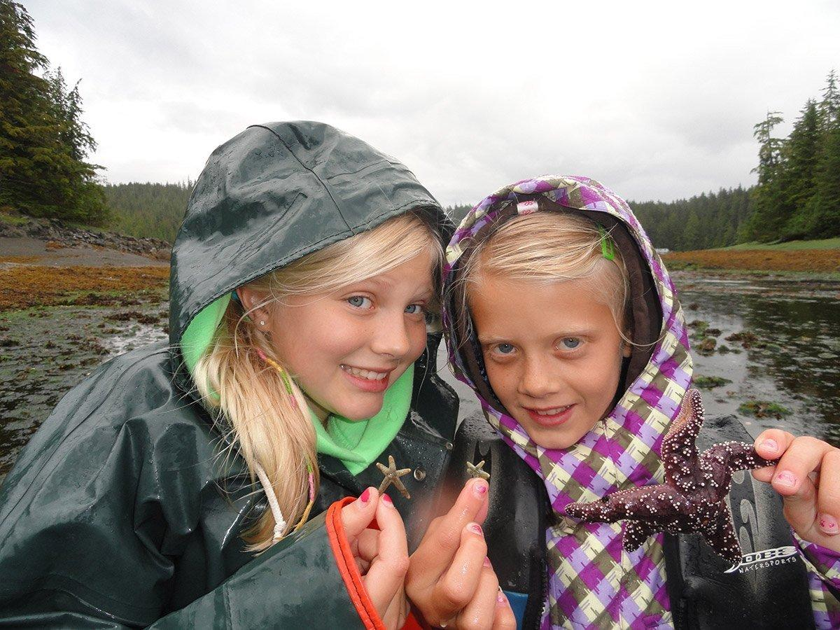 Girls find starfish in tide pools on the lodge property
