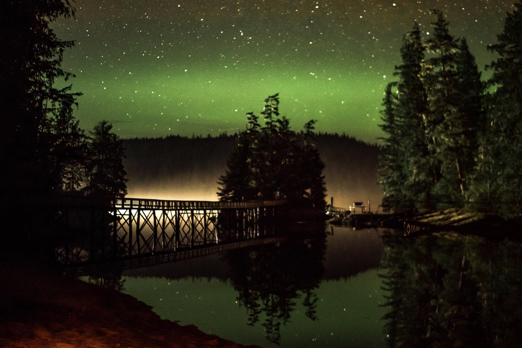 Night sky reveals an amazing aurora over the boardwalk